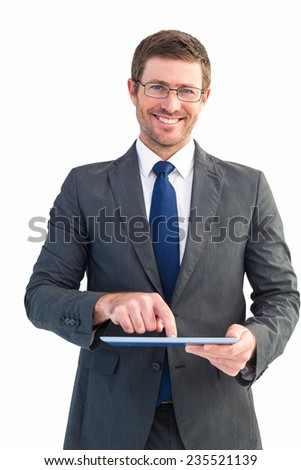 Businessman using his tablet pc on white background - stock photo