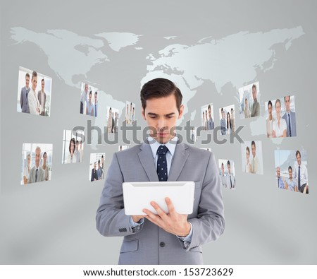 Businessman using his tablet pc with digital interface on background