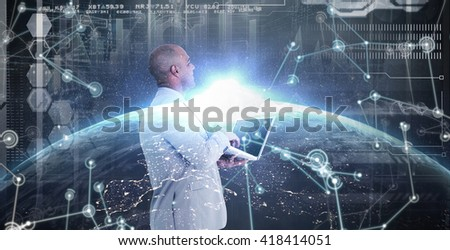 Businessman using laptop against image of a earth - stock photo