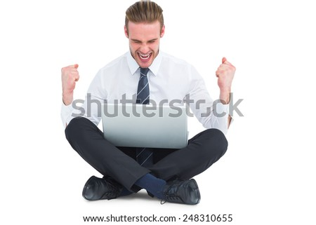 Businessman using laptop and cheering on white background