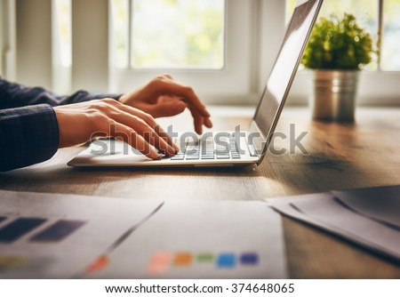 businessman using laptop computer sitting working office. - stock photo