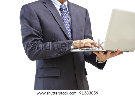 Businessman using laptop computer standing, isolated on white background