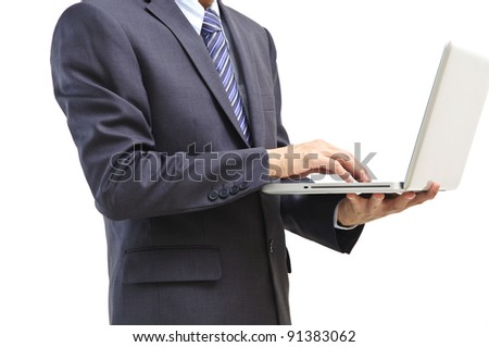 Businessman using laptop computer standing, isolated on white background - stock photo