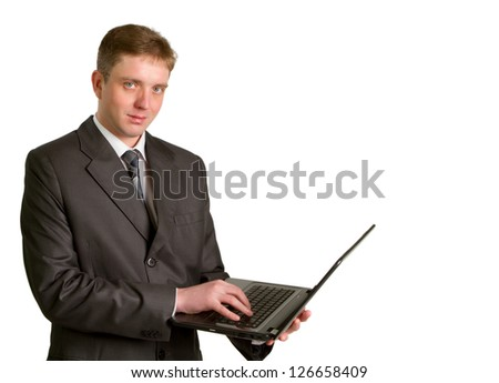Businessman using laptop computer, standing, smiling. Isolated on white background.