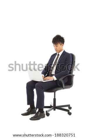 businessman using laptop on the chair