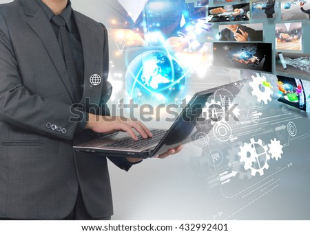 Businessman using laptop with social icons and virtual screen, Social media concept.
