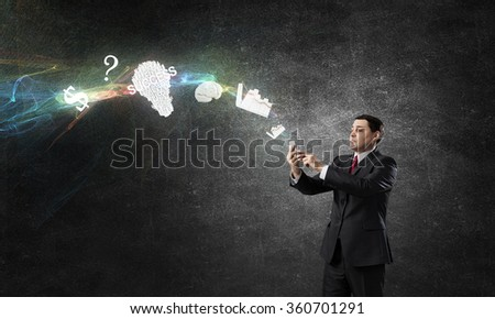 Businessman using mobile application - stock photo