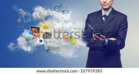 Businessman using mobile phone with touchscreen and cloudy service with streaming images, email, multimedia symbols