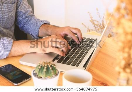 Businessman using mobile smart phone.workplace,inspiration - stock photo