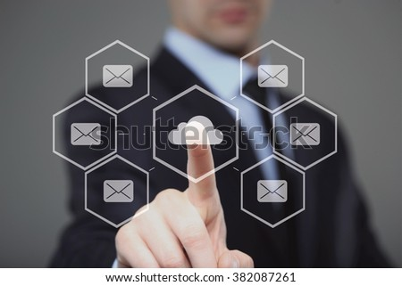 businessman using modern computer, pressing button on virtual screen.