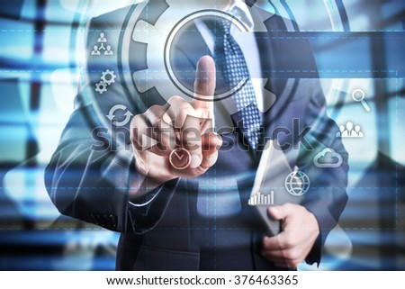 Businessman using modern computer, pressing button on virtual screen? business, technology and internet concept. - stock photo