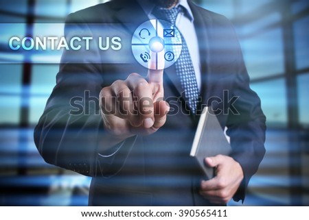 businessman using modern computer, pressing contact us button on virtual screen. business strategy as concept - stock photo