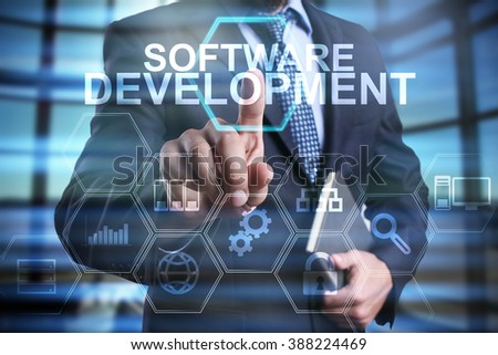 businessman using modern computer, pressing software development button on virtual screen. business strategy as concept - stock photo