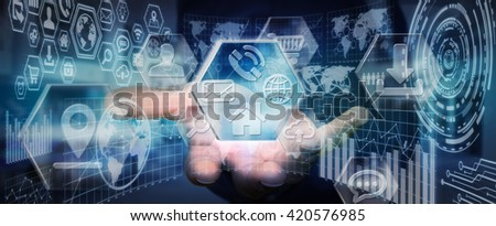 Businessman using modern digital icons interface with charts - stock photo