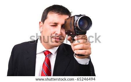 Businessman using retro Super 8mm film camera