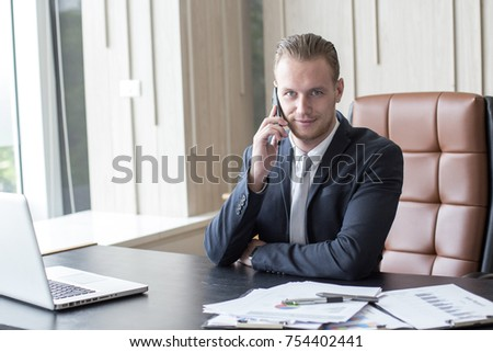 Businessman using Smartphone while working at office. Businessman have a busy time. Man working Concept
