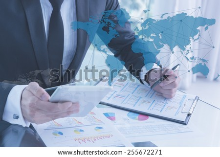 businessman using tablet, business globalization concept - stock photo