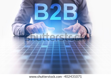 Businessman using tablet pc and select B2B - stock photo