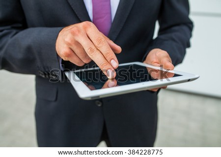 Businessman using tablet pc. Close up