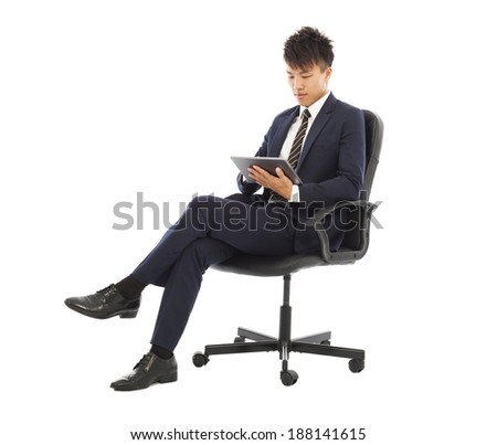 businessman using tablet pc on the chair - stock photo