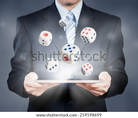 Businessman using tablet showing dice, risk management concept - stock photo