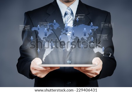 Businessman using tablet with digital visual object, human resource in business concept - stock photo