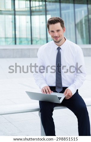 Businessman using the notebook computer at outdoor