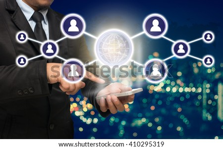 Businessman using the smart phone with the Social media symbol on Blurred Photo bokeh of cityscape, Elements of this image furnished by NASA, Business network concept