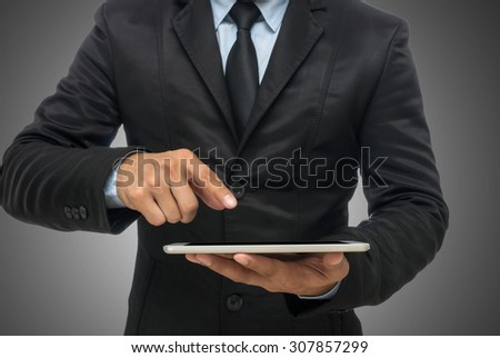 Businessman using the tablet on gray background, include clipping path