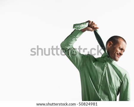 Businessman using tie as a noose - stock photo