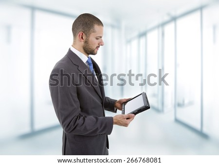 businessman using touch pad of tablet pc, at the office - stock photo
