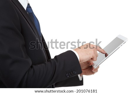 Businessman using touch pad of tablet pc on  white background - stock photo