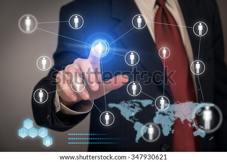 Businessman using virtual touch screen