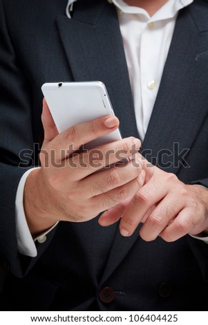 Businessman using white smart phone