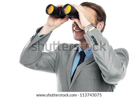 Businessman viewing through binoculars isolated against white background - stock photo