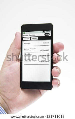 Businessman views mobile banking details - stock photo
