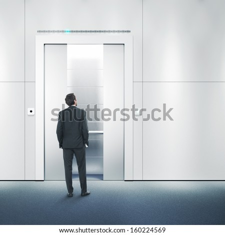 businessman waiting for a lift - stock photo