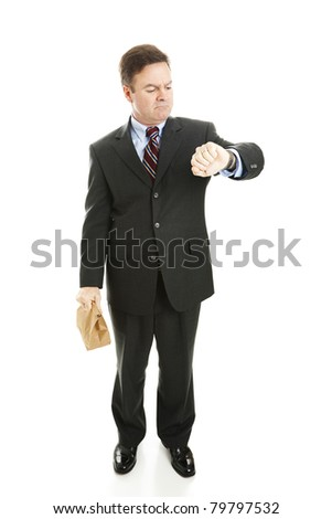 Businessman waiting for a ride to work, holding his lunch bag and checking the time.  Isolated on white. - stock photo