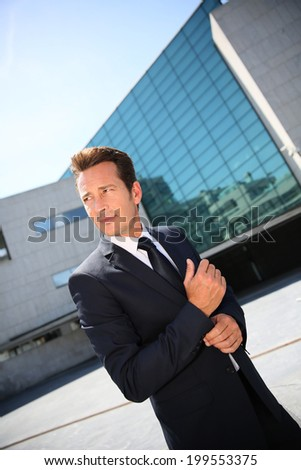 Businessman waiting for meeting outside building
