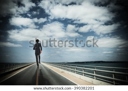Businessman walking a straight road