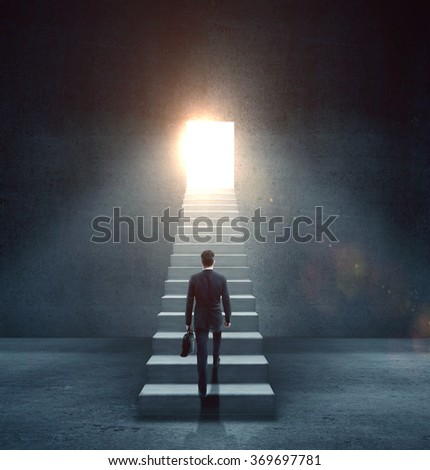 businessman walking at opened door and staircase - stock photo