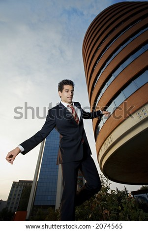 businessman walking hanging on. The head is in clear focus and the body is a bit blurred - stock photo
