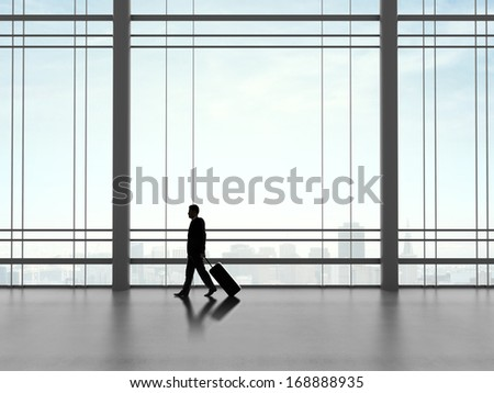businessman walking in futuristic office with luggage