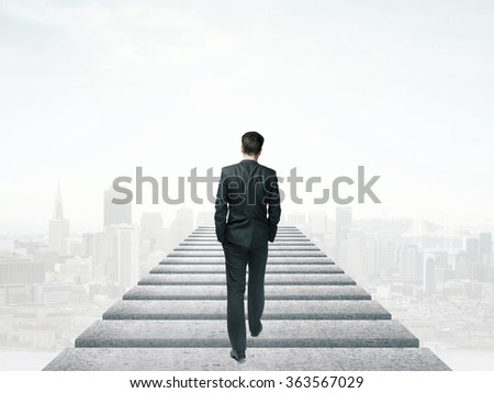 businessman walking in the sky and city - stock photo