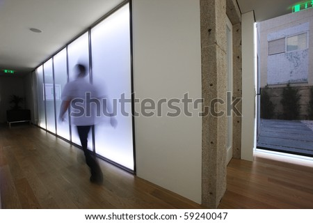 Businessman walking inside the office - stock photo
