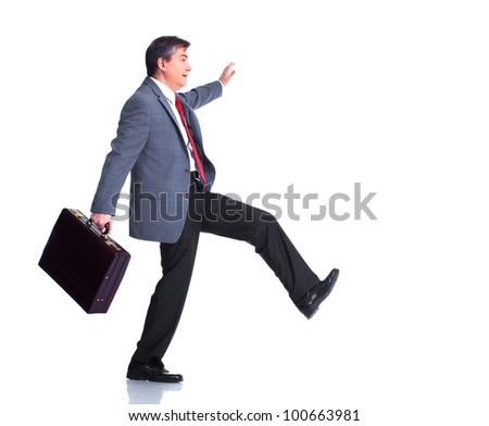 Businessman walking. Isolated on white background. - stock photo