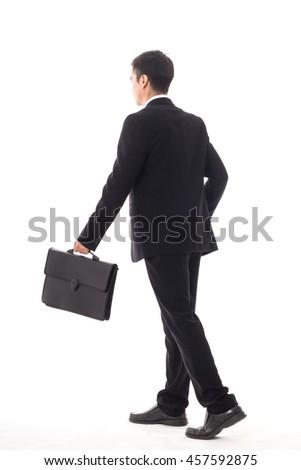 Businessman walking isolated with white background. - stock photo