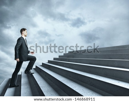 businessman walking near ladder in sky - stock photo