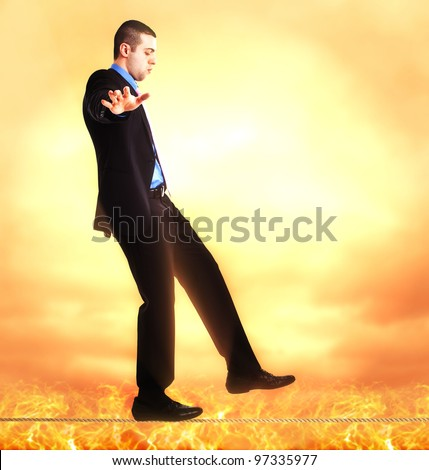 Businessman walking on a rope
