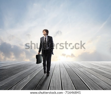 Businessman walking on a wooden floor